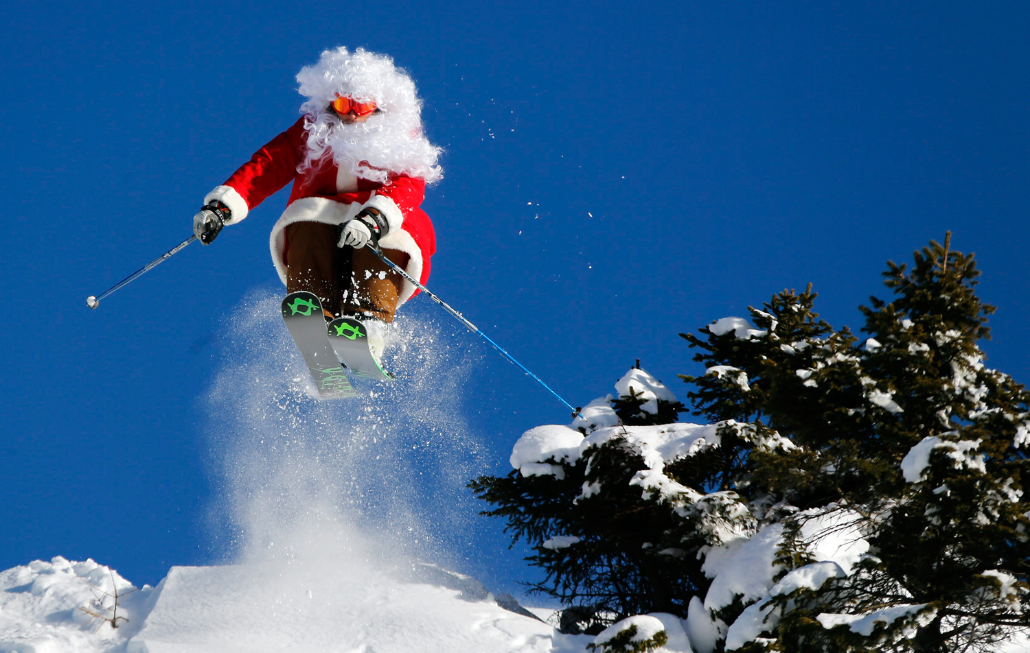 Father Christmas skiing